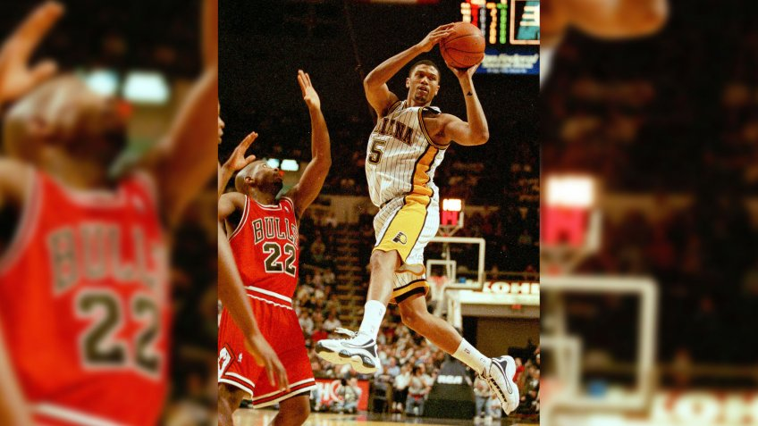 ROSE BOOTH Indiana Pacers guard Jalen Rose, right, looks to pass as he drives the lane and is stopped by Chicago Bulls forward Keith Booth in the first quarter of the final exhibition game in Indianapolis, .