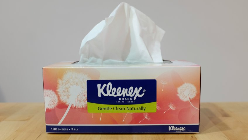 Ampang, Kuala Lumpur - April 12, 2018 : Photo taken of a box of Kleenex on wooden surface & white background.