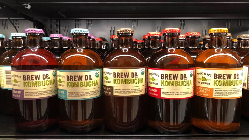 Alameda, CA - December 31, 2017: Grocery store shelf with bottles of Brew DR Kombucha in various flavors.