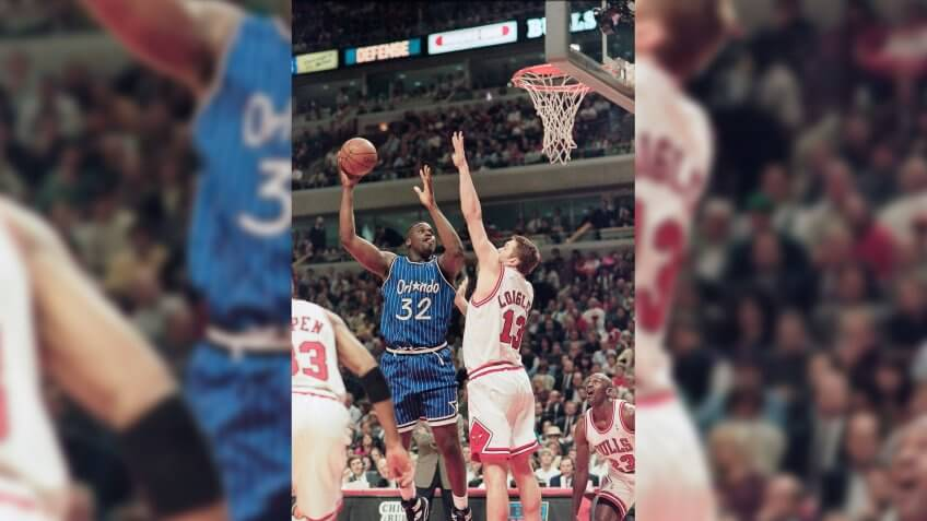 Orlando Magic's Shaquille O'Neal shoots over Chicago Bulls center Luc Longley during the Magic's 108-102 victory, in Chicago.