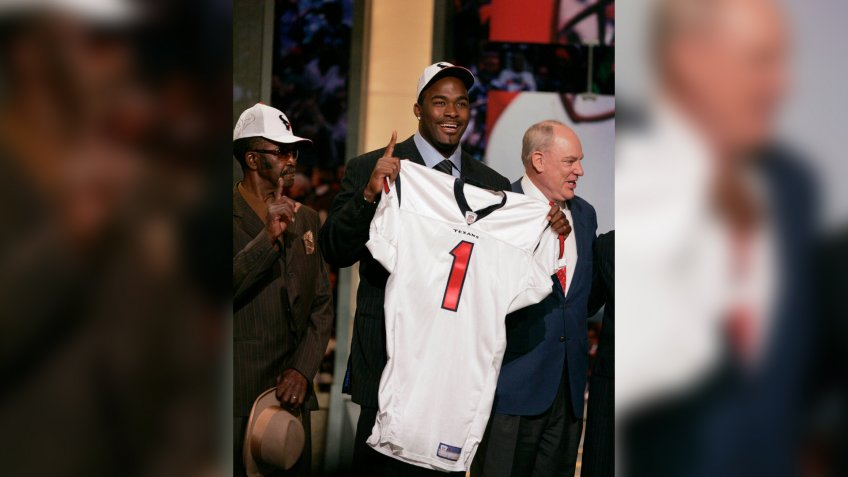 Mandatory Credit: Photo by Julie Jacobson/AP/Shutterstock (6032826a)Mario Williams RAW FILE** Mario Williams of North Carolina State holds up a Houston Texans jersey after being picked by the team as the No.