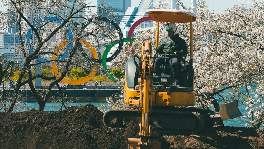 Mandatory Credit: Photo by Eugene Hoshiko/AP/Shutterstock (10592028c)Worker operates an excavator near the Olympic rings at Tokyo's Odaiba district .
