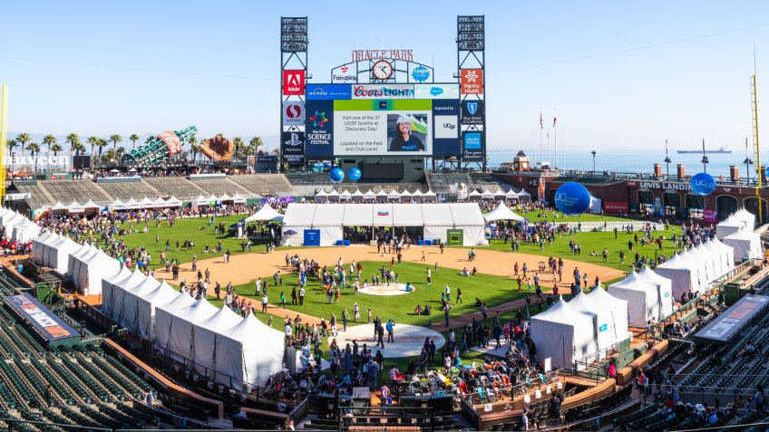 Nov 2, 2019 San Francisco / CA / USA - Panoramic view of Oracle Park during the Bay Area Science Festival event; People visiting the business representative booths set up on the field.