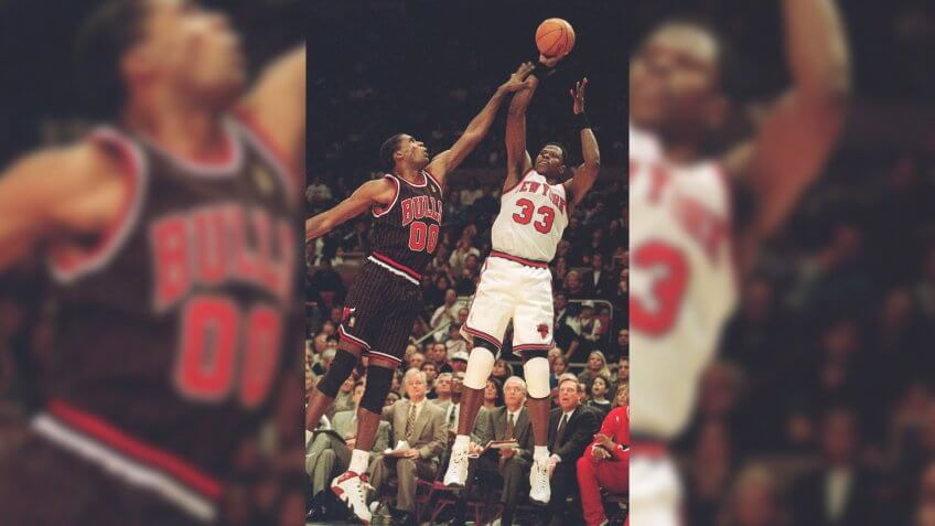 EWING PARISH New York Knicks Patrick Ewing, right, takes the final shot of the game over Chicago Bulls Robert Parish, left, during game action, in New York.