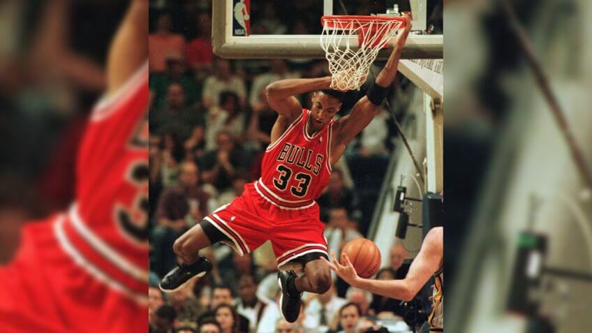 Chicago Bulls' Scottie Pippen hangs on the rim after dunking against the Indiana Pacers during the first half of Game 3 of the Eastern Conference finals in IndianapolisBULLS PACERS, INDIANAPOLIS, USA.