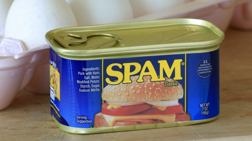 LLANO, TEXAS - AUGUST 24, 2014: Can of unopened Spam in foreground with eggs behind.