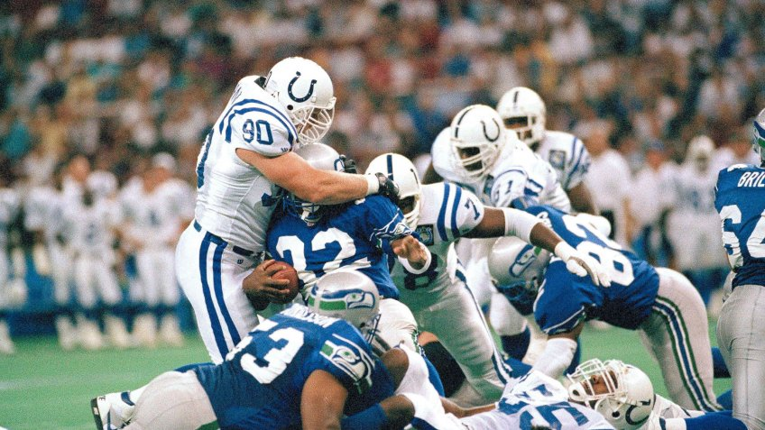 Mandatory Credit: Photo by Barry Sweet/AP/Shutterstock (6034262a)Steve Emtman (90) of the Indianapolis Colts tackles running back John L.