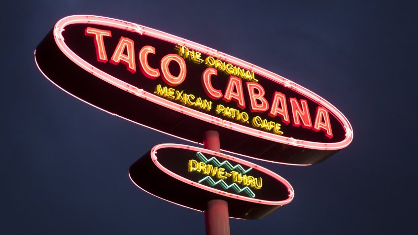 DALLAS, Tx, USA - APR 17, 2016: Taco Cabana Mexican fast food restaurant logo illuminated at night.