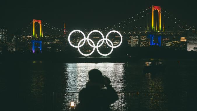 Mandatory Credit: Photo by Jae C Hong/AP/Shutterstock (10578454a)A photographer takes pictures of the illuminated Olympic rings in front of the Rainbow Bridge, in the Odaiba district of Tokyo.
