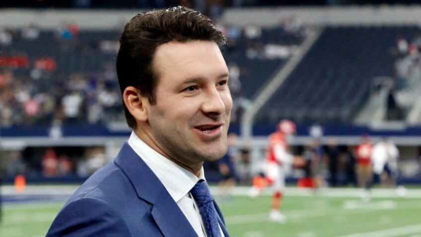 CBS football analyst Tony Romo walks across the field during warm ups before an NFL football game between the Kansas City Chiefs and Dallas Cowboys, in Arlington, Texas.