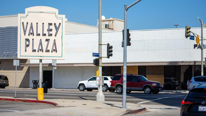 North Hollywood, California / USA - September 18, 2019: The original Valley Plaza signage, vintage from the 1950s and 1960s, at the historical Valley Plaza shopping center.