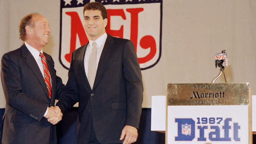 Mandatory Credit: Photo by Ray Stubblebine/AP/Shutterstock (6034808a)Vinny Testaverde Vinny Testaverde, right, the Heisman Trophy-winning quarterback from the University of Miami, shakes hands with NFL commissioner Pete Rozelle during the NFL draft in New York on .
