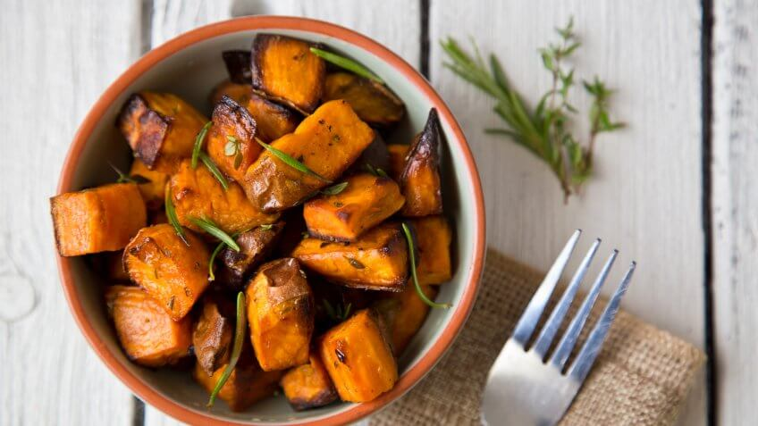 Oven roasted sweet potatoes with thyme and rosemary are an easy to prepare, delicious and healthy snack that contains lots of vitamins and serves as a natural energy booster.