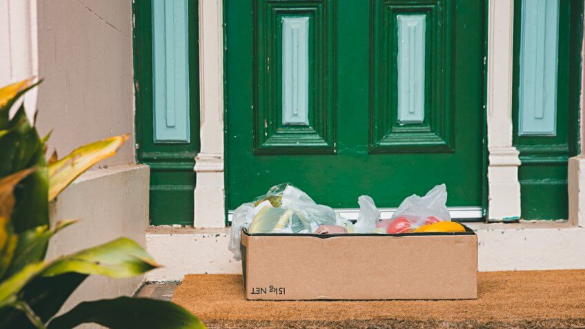 A box of fresh fruit and vegetables left at the front door during social distancing of Coronavirus.