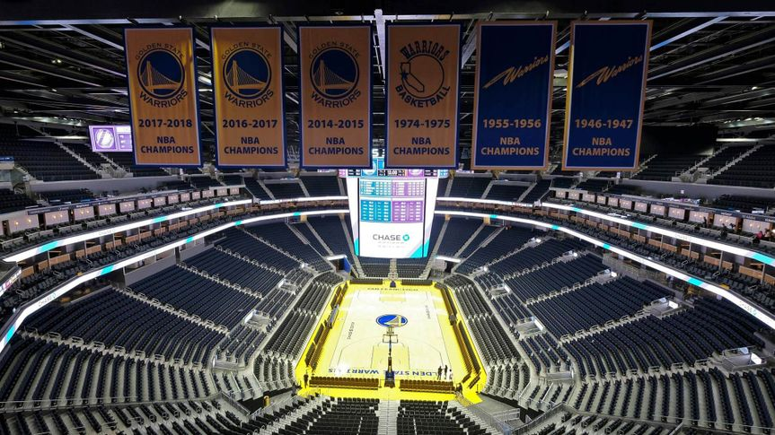 Mandatory Credit: Photo by Eric Risberg/AP/Shutterstock (10580271a)The Golden State Warriors championship banners hang above the seating and basketball court at the Chase Center in San Francisco.