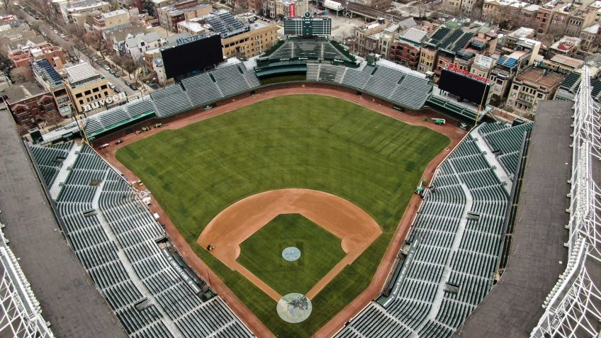 Mandatory Credit: Photo by TANNEN MAURY/EPA-EFE/Shutterstock (10594933c)An aerial photo made with a drone shows Wrigley Field, home of the Chicago Cubs baseball team, on what was supposed to be the opening day of the 2020 baseball season, in Chicago, Illinois, USA, 26 March 2020.