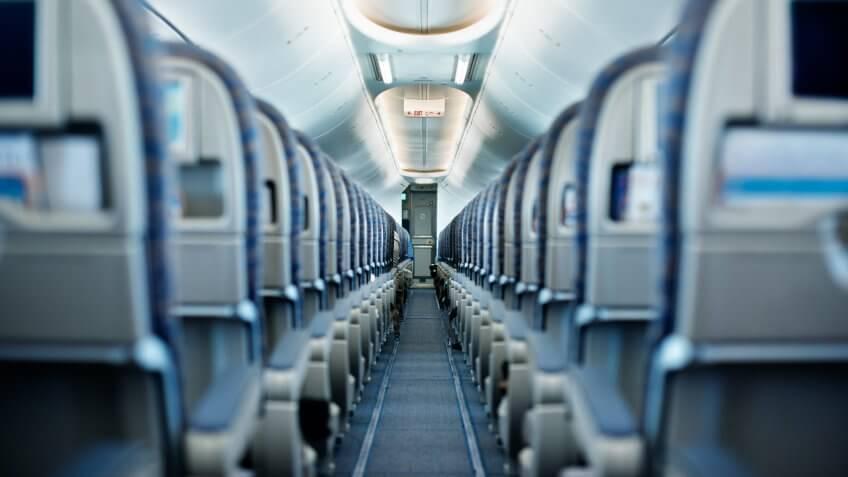 Row of empty airplane seats.