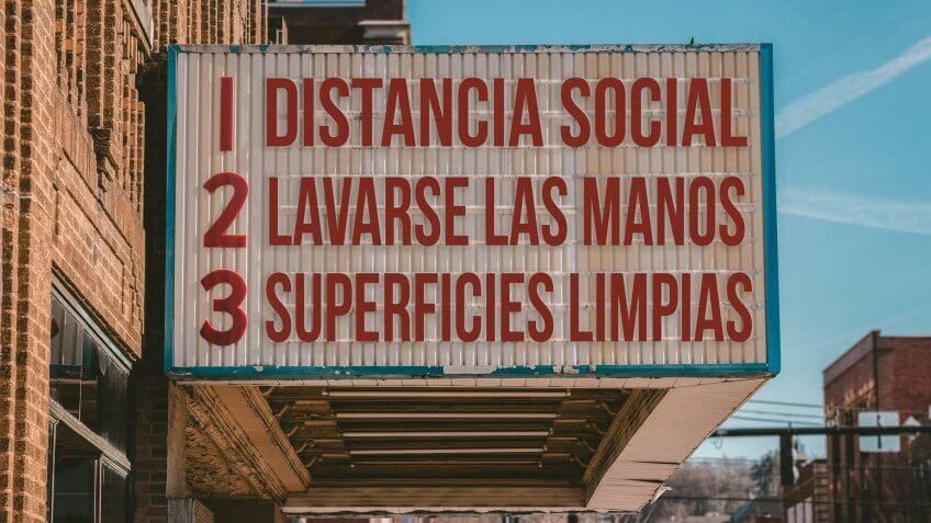 Spanish movie cinema billboard with three rules to avoid the coronavirus epidemic.
