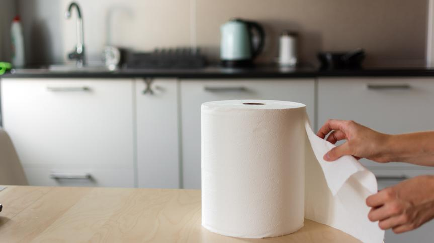 Huge roll of paper towels on kitchen table.