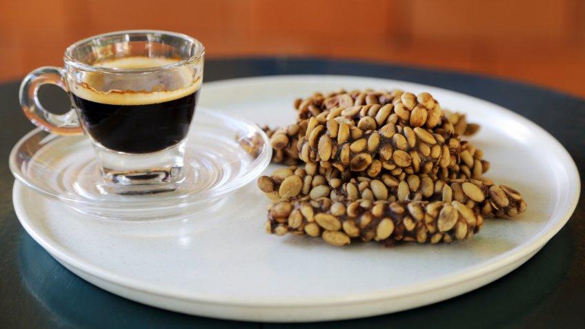 Kopi Luwak Coffee Bean or Civet coffee bean with Cup of black Kopi Luwak coffee, world's most expensive coffee, chumphon, Thailand.