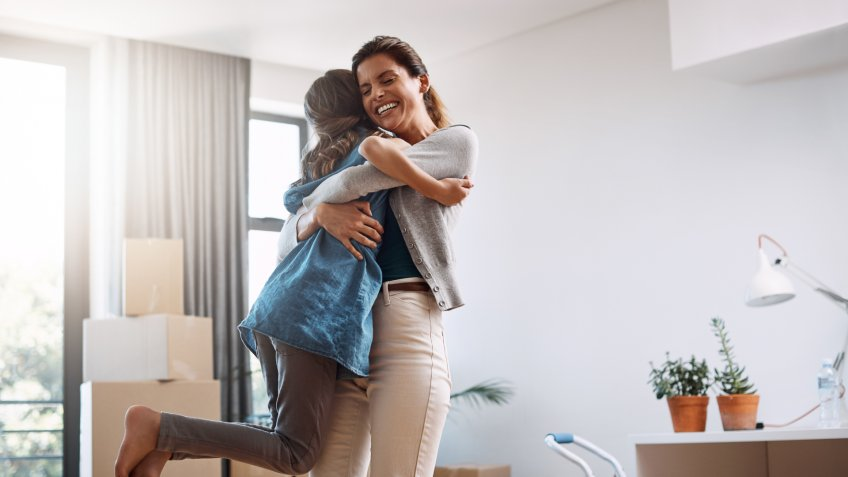 Cropped shot of an attractive young woman and her daughter dancing while moving into their new home.