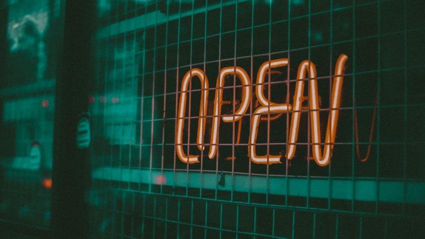 """Evening, Orange light bulb, write """" OPEN """" in Karaoke shop."""