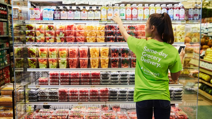shopper selecting juices for grocery delivery - Instacart
