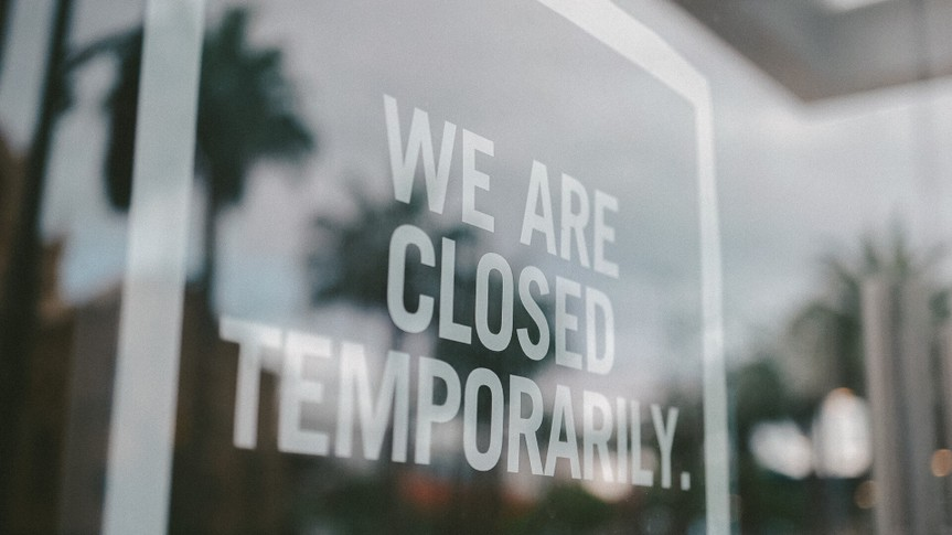 shot of store closed sign.