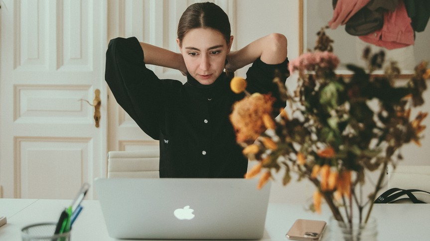 woman sitting in front of laptop.