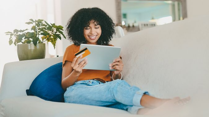 young woman using a store credit card