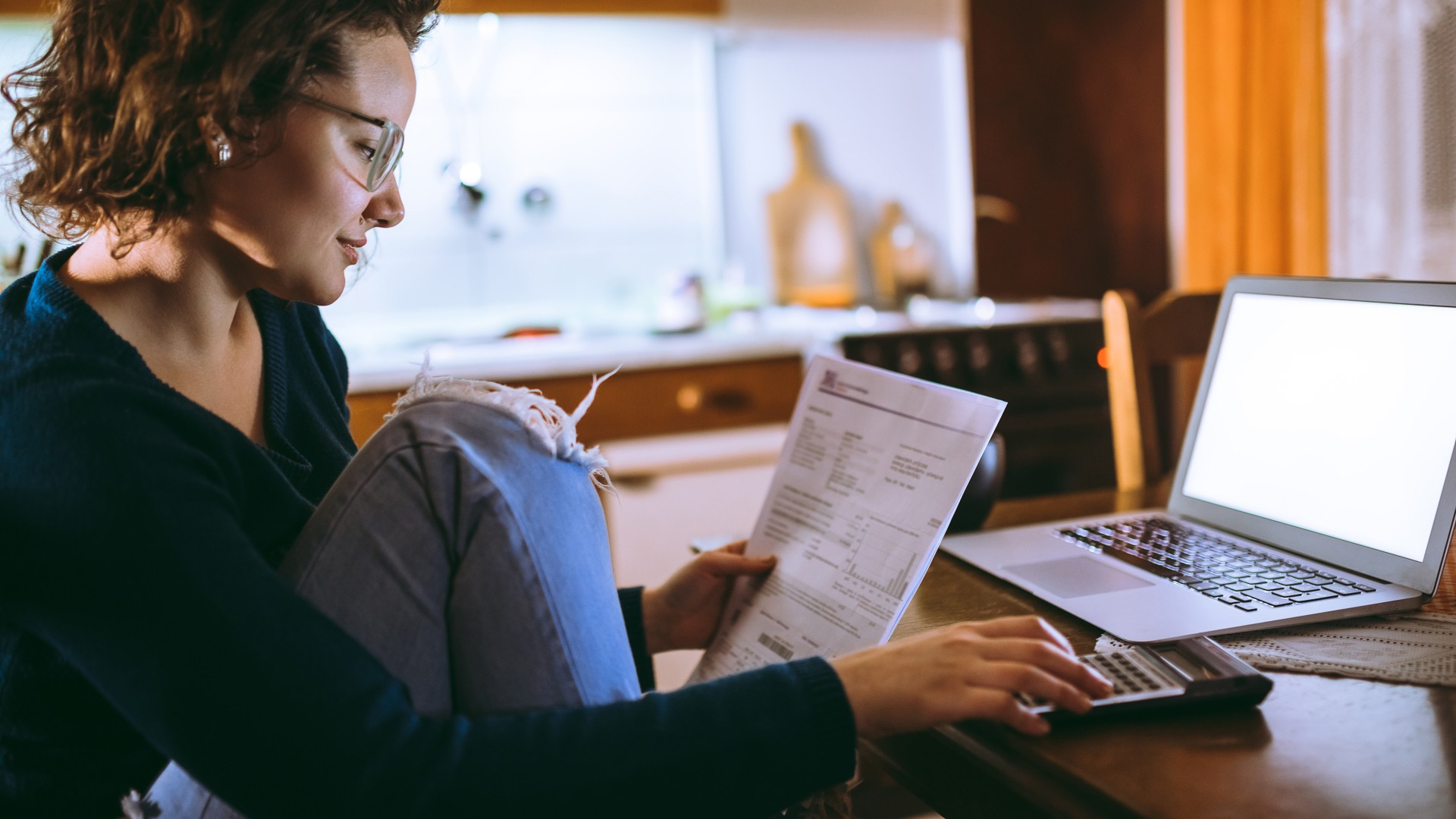 Woman going through bills at home.
