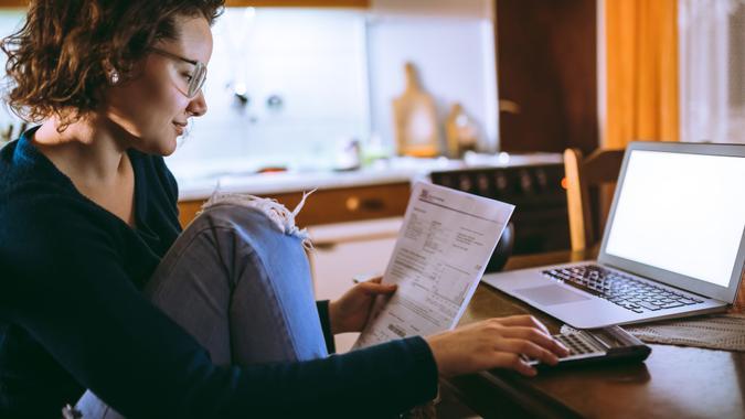 Woman going through bills at home.