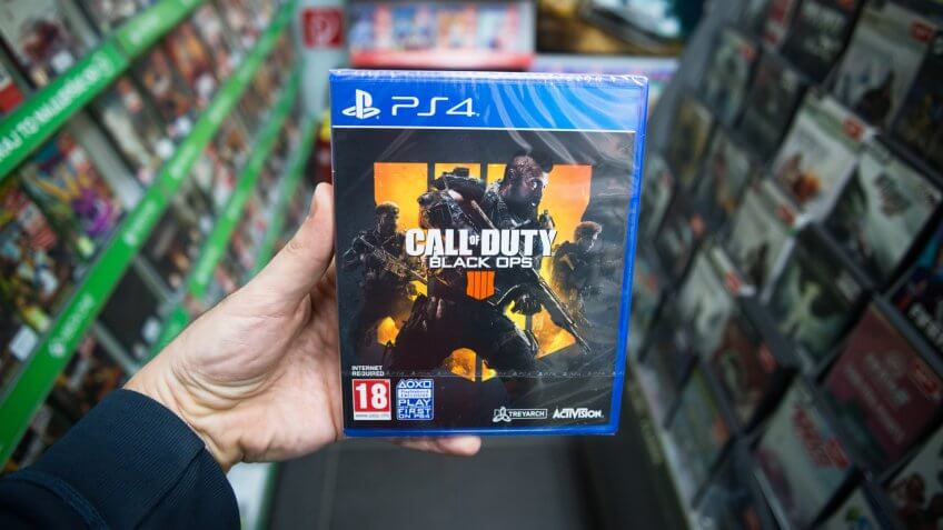 Bratislava, Slovakia, march 8 2019: Man holding Call of Duty Black Ops 4 videogame on Sony Playstation 4 console in store.