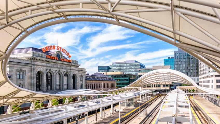 Denver, USA - A panoramic image showing the tracks of Denver's Union Station partially covered by the canopy architecture.