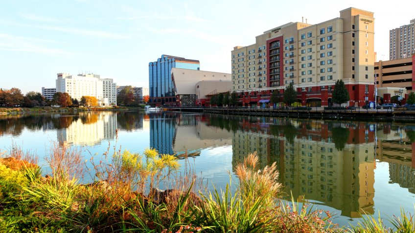 Gaithersburg, Maryland, USA - November 2, 2016: Daytime view of the Gaithersburg skyline reflecting on a pond along the Washingtonian waterfront.