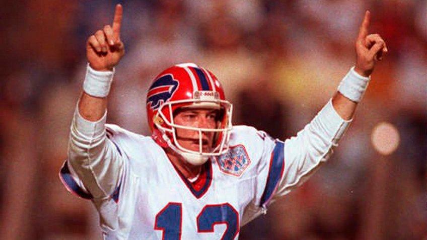 Mandatory Credit: Photo by Lennox Mclendon/AP/Shutterstock (6577766a)JIM KELLY Buffalo Bills quarterback Jim Kelly celebrates the Bills first touchdown against the New York Giants in Super Bowl XXV in Tampa onSUPER BOWL BILLS GIANTS KELLY, TAMPA, USA.