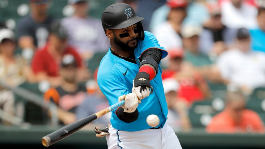 Mandatory Credit: Photo by Julio Cortez/AP/Shutterstock (10579206j)Miami Marlins' Jonathan Villar singles off Washington Nationals pitcher Ben Braymer during the first inning of a spring training baseball game, in Jupiter, FlaNationals Marlins Spring Baseball, Jupiter, USA - 10 Mar 2020.