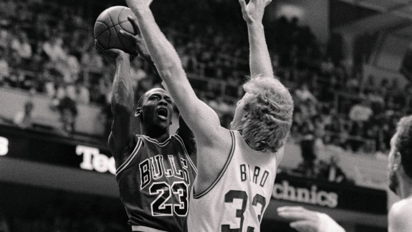 (Original Caption) Chicago Bulls' Michael Jordan goes up for basket as Celtics' guard Larry Bird attempts to block him during the first quarter action of game 2 of the opening round of the playoffs at Boston Garden.