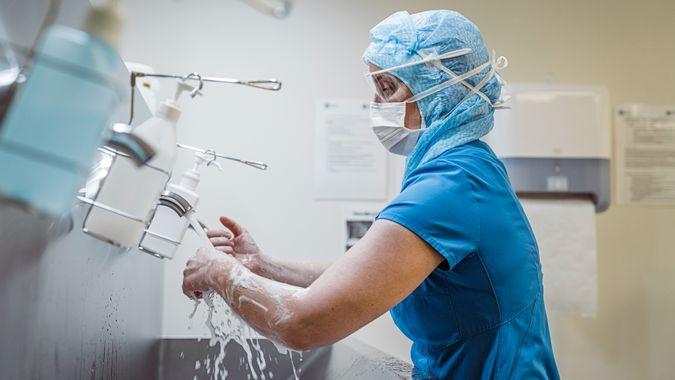 Nurse doing hand wash to prevent spread of Corona virus.