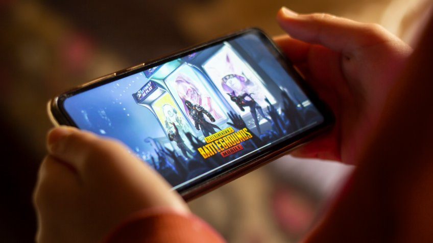 Khemisset, Morocco - april 14, 2020: Close up gamer hand holding a smartphone with Playerunknown's Battlegrounds.