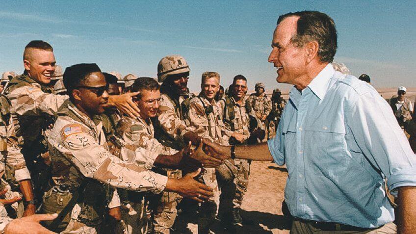 President George H W Bush talks with Saudi Arabia troops 1990 Pe