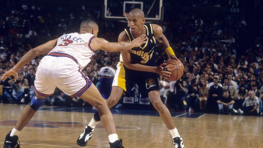 MANHATTAN, NY - CIRCA 1990's: Guard Reggie Miller #31 of the Indiana Pacers is guarded closely by John Starks #3 of the New York Knicks circa mid 1990's during an NBA basketball game at Madison Square Garden in Manhattan, New York.