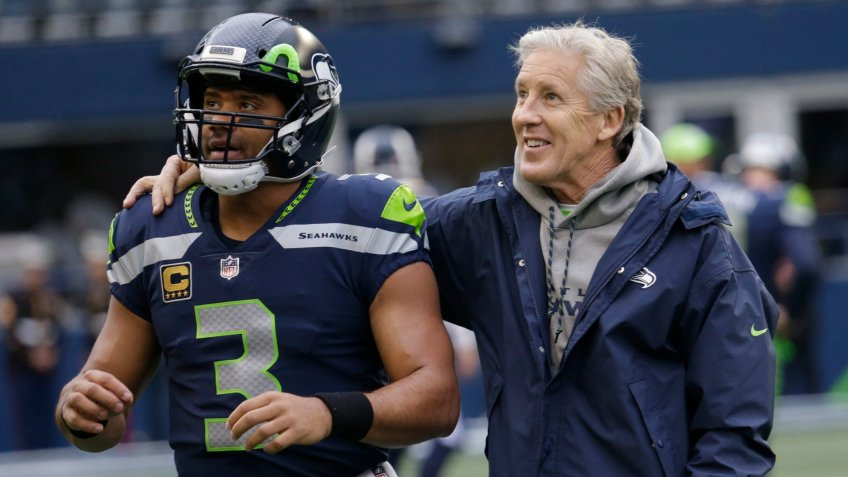 Mandatory Credit: Photo by Elaine Thompson/AP/Shutterstock (9295612g)Seattle Seahawks head coach Pete Carroll, right, stands with quarterback Russell Wilson (3) before an NFL football game against the Los Angeles Rams, in SeattleRams Seahawks Football, Seattle, USA - 17 Dec 2017.