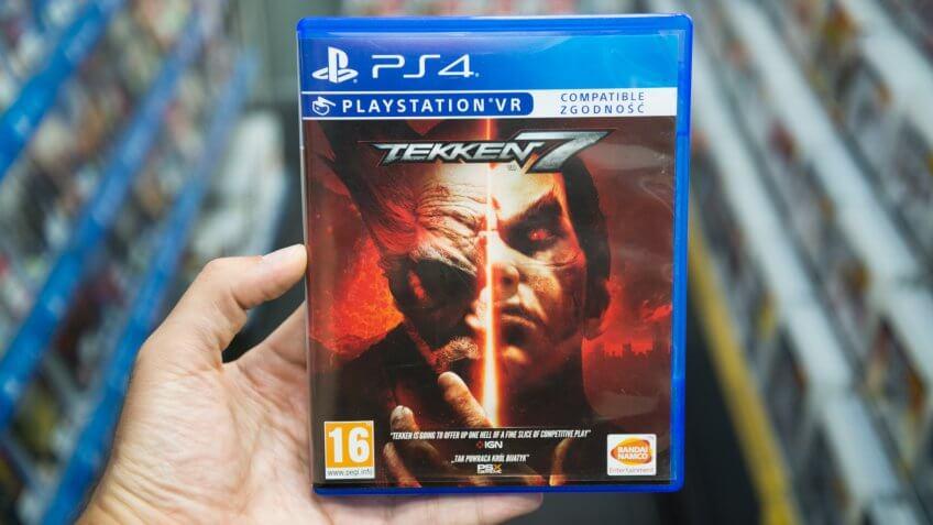 Bratislava, Slovakia, June 1, 2017: Man holding Tekken 7 videogame on Sony Playstation 4 console in store.
