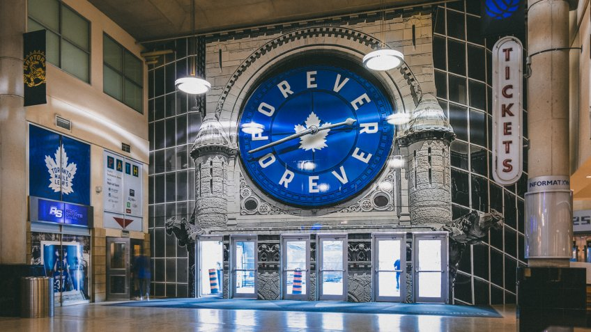 """TORONTO, CANADA - October 4, 2019: Inside Scotiabank Arena Galleria - Toronto Maple Leafs logo surrounded by slogan """"Leafs Forever"""" on a clock."""