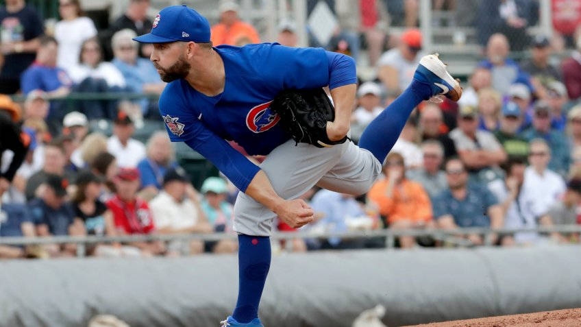 Mandatory Credit: Photo by Matt York/AP/Shutterstock (10579283a)Chicago Cubs pitcher Tyler Chatwood throws against the San Francisco Giants during the first inning of a spring training baseball game, in Scottsdale, ArizCubs Giants Spring Baseball, Scottsdale, USA - 10 Mar 2020.