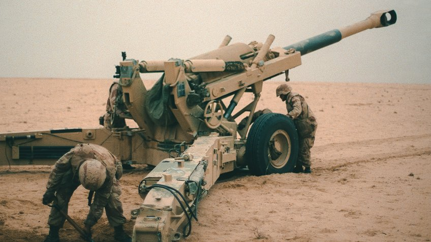 Marine artillerymen set up their M-198 155mm howitzer for a fire mission against Iraqi positions during Operation Desert Storm.