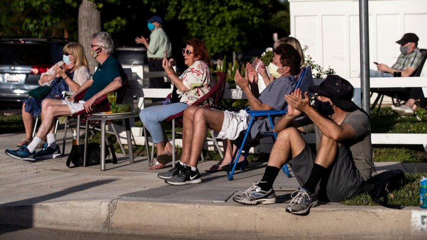 ATTENTION: This Image is part of a PHOTO SETMandatory Credit: Photo by ETIENNE LAURENT/EPA-EFE/Shutterstock (10649279o)Neighbors react as musician Adam Chester performs during his weekly neighborhood concert called 'Quaranchella' amid the coronavirus disease (COVID-19) pandemic in Sherman Oaks, North-West of Los Angeles, California, 16 May 2020.