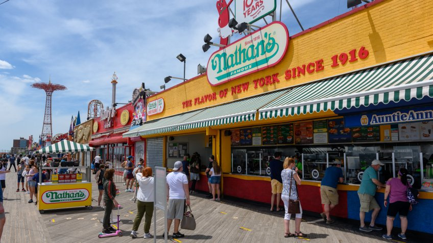 Mandatory Credit: Photo by Erik Pendzich/Shutterstock (10649320j)People observe social distancing as the stand in line at Nathan's Famous Hot Dogs on the Coney Island boardwalk during the COVID-19 outbreak.