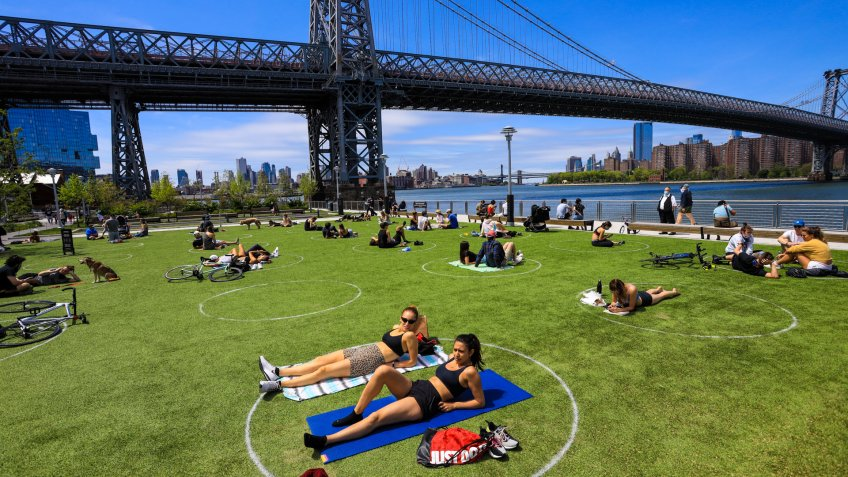 Mandatory Credit: Photo by Vanessa Carvalho/Shutterstock (10649773br)People are seen practising social distancing in white circles in Domino Park, during the Covid-19 pandemic on May 17, 2020 the in Brooklyn borough of New York City.